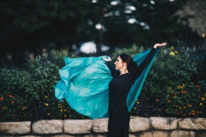 Lurainya Koerber of Moon Gypsy Productions belly dance demo outdoors with teal silk veil