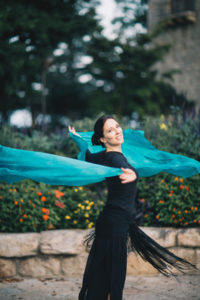 Lurainya bellydancing in black fringe with teal silk veil swirling