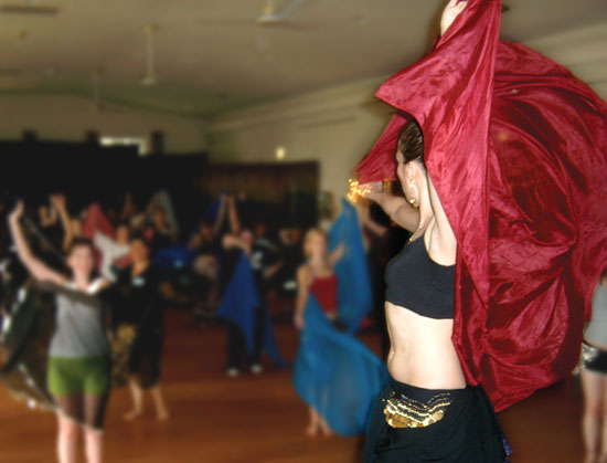 Lurainya of Moon Gypsy Productions teaching belly dance veil workshop in Doylestown, PA, using red silk veil