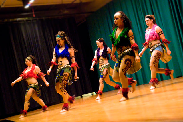 Lurainya and her dance company performing Tahitian fusion at her annual World Dance Extravaganza, feather costumes