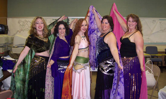 Lurainya Koerber's students with veils performing in MoonGypsy Productions bellydancing student recital