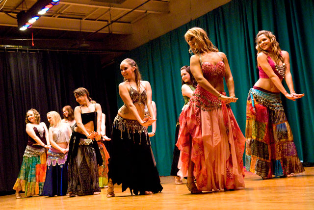 Students performing recital number in coin scarves and long colorful skirts at Lurainya's annual student recital