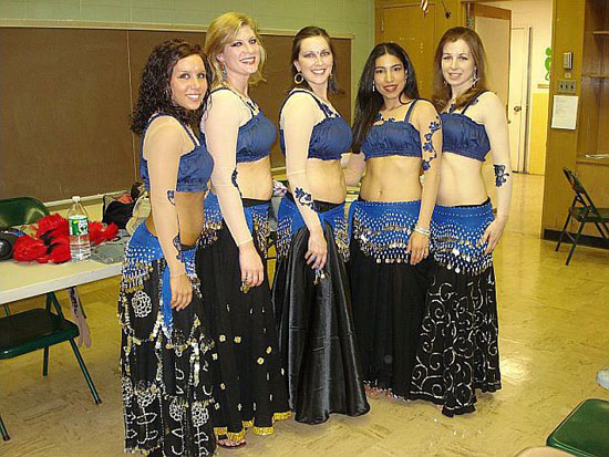 Lurainya Koerber's students performing in coin costumes during MoonGypsy Productions bellydancing student recital