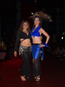 Lurainya with one of her students backstage at World Cafe Live for Fuze Fest Philadelphia in a blue feather costume