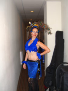 Lurainya Koerber backstage at World Cafe Live at Fuze Fest in a blue peacock feather samba fusion costume and elaborate eye makeup