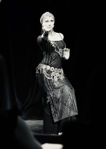 Lurainya Koerber performing bellydance at the Bucks Fever Talent Show, photo in black and white