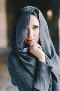 Lurainya Koerber modeling headshot photo showing blue eyes behind draping scarf